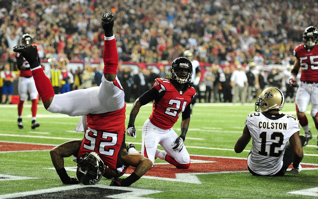 . William Moore #25 and Desmond Trufant #21 of the Atlanta Falcons break up a pass intended for Marques Colston #12 of the New Orleans Saints at the Georgia Dome on November 21, 2013 in Atlanta, Georgia. (Photo by Scott Cunningham/Getty Images)