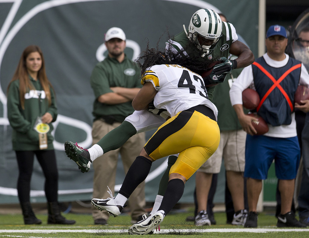 . Wide Receiver Stephen Hill #84 of the New York Jets is hit by safety Troy Polamalu #43 of the Pittsburgh Steelers on October 13, 2013 at MetLife Stadium in East Rutherford, New Jersey. (Photo by Mitchell Leff/Getty Images)