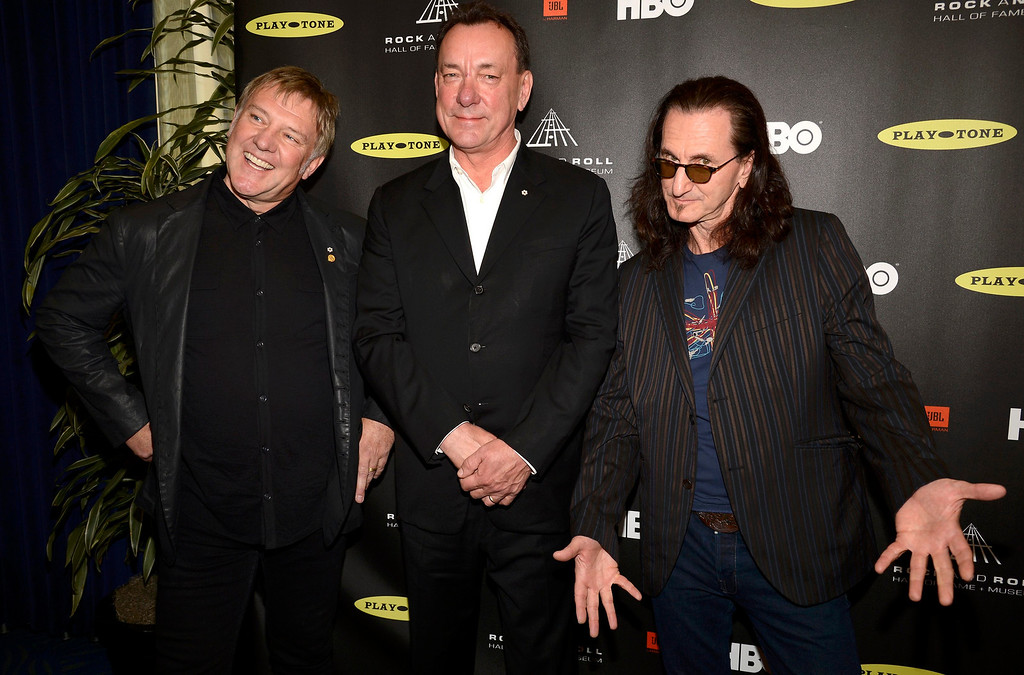 . Inductees Canadian rockers Rush; Alex Lifeson, left, Neil Peart, center, and Geddy Lee arrive at the 2013 Rock and Roll Hall of Fame induction ceremony in Los Angeles April 18, 2013.   REUTERS/Phil McCarten