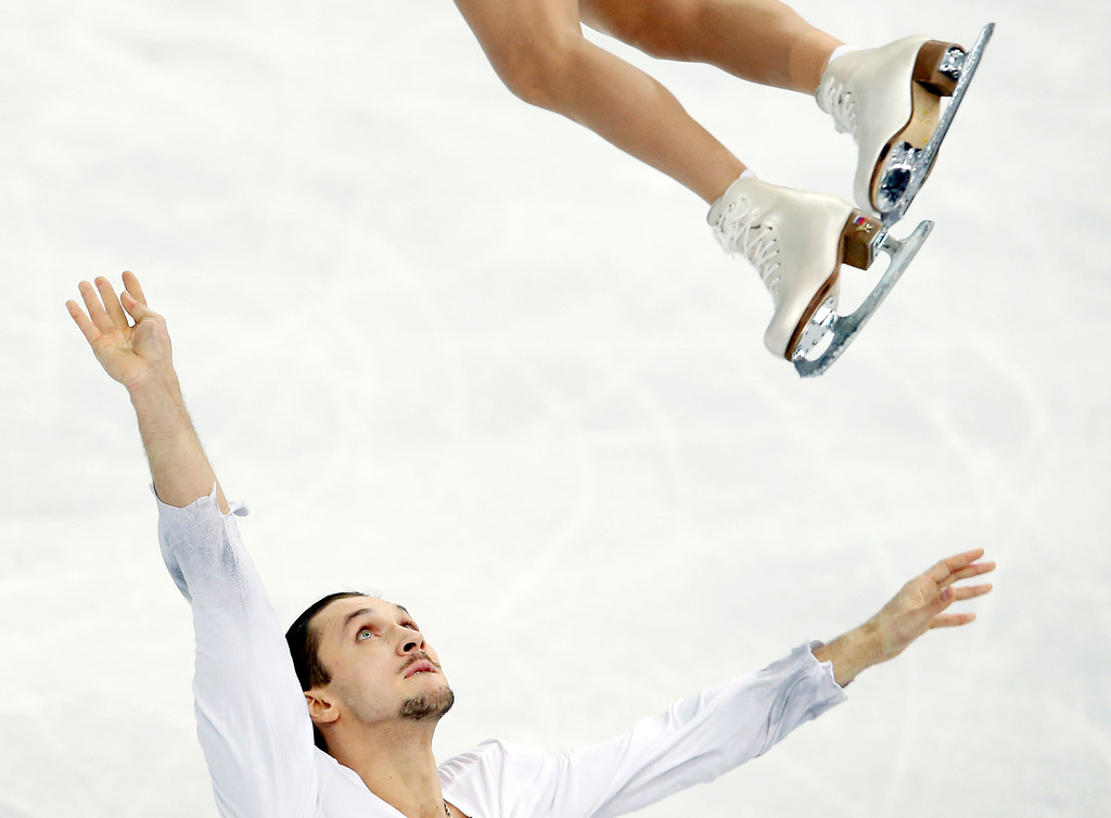 . Russia\'s Maxim Trankov, bottom, and Tatiana Volosozhar perform their routine in the pairs free skate figure skating competition at the Winter Olympics, Wednesday, Feb. 12, 2014, in Sochi, Russia. (AP Photo/Star Tribune, Carlos Gonzalez)