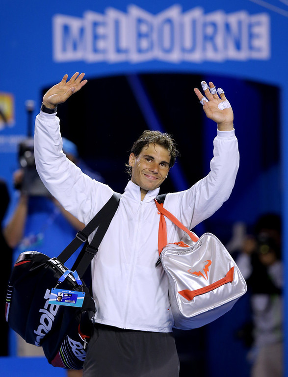 . Rafael Nadal of Spain walks off the court  after defeating Roger Federer of Switzerland in their semifinal at the Australian Open tennis championship in Melbourne, Australia, Friday, Jan. 24, 2014.(AP Photo/Aaron Favila)