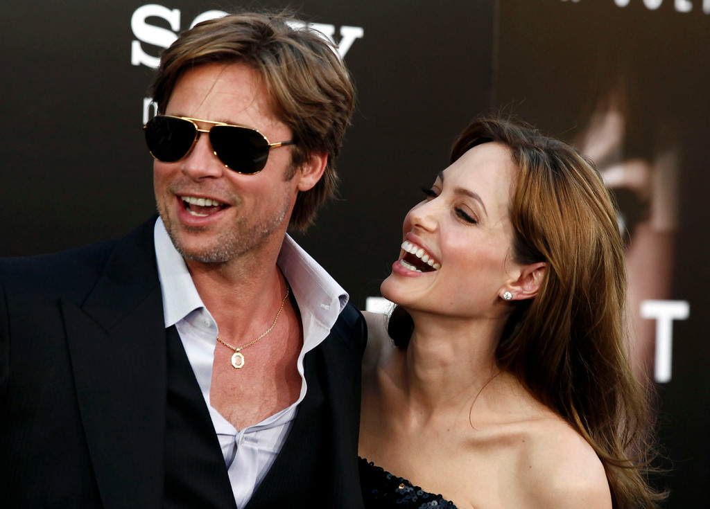""". n this Monday, July 19, 2010, file photo, cast member Angelina Jolie, right and Brad Pitt arrive at the premiere of \""""Salt\"""" in Los Angeles. (AP Photo/Matt Sayles, File)"""