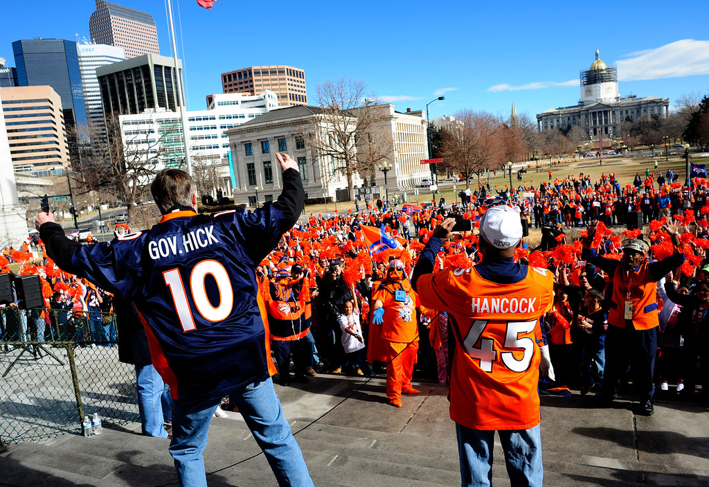 . Governor John Hickenlooper and Denver Mayor Michael Hancock speak to fans during a rally to send off the Denver Broncos, at the City and County Building in Denver, Colorado, Sunday, January 26, 2014. The noon rally brought out scores of supporters and included an appearance by Governor John Hickenlooper and Denver Mayor Michael Hancock.  (Photo By Brenden Neville / Special to The Denver Post)