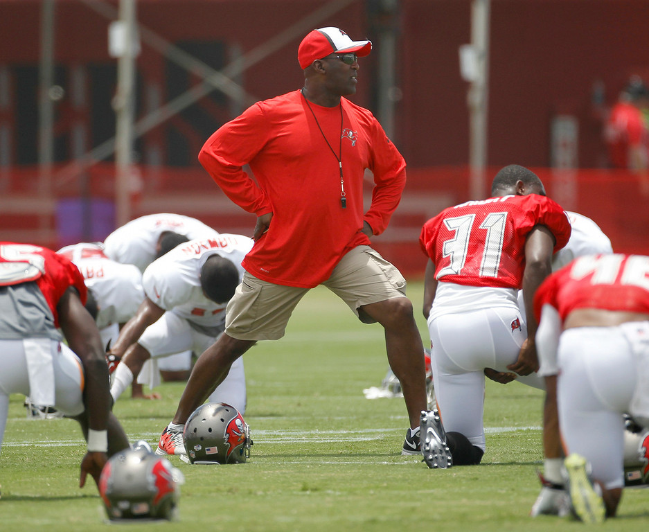 . Head coach Lovie Smith stretches during Bucs training camp at One Buc Place  in Tampa, Fla., Monday, July 28, 2014. (AP Photo/The Tampa Bay Times, James Borchuck)