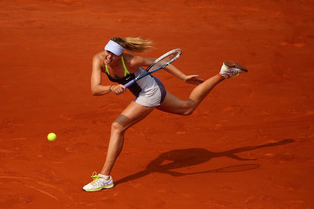 . Maria Sharapova of Russia plays a forehand in her Women\'s Singles Final match against Serena Williams of United States of America during day fourteen of French Open at Roland Garros on June 8, 2013 in Paris, France.  (Photo by Julian Finney/Getty Images)