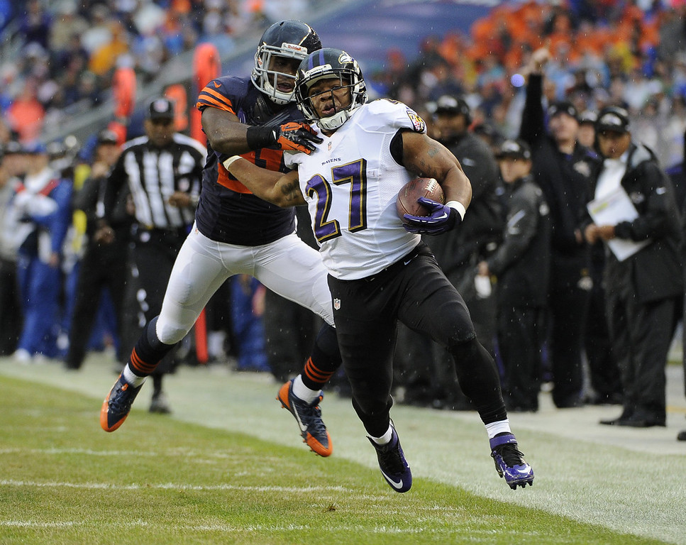 . Ray Rice #27 of the Baltimore Ravens is tackled by Major Wright #21 of the Chicago Bears during the first quarter during the first quarter on November 17, 2013 at Soldier Field in Chicago, Illinois. (Photo by David Banks/Getty Images)