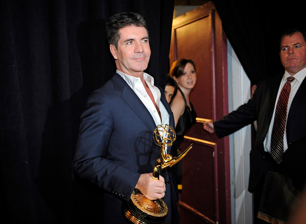 ". Simon Cowell is seen after receiving ""The Founders Award\"" at the 38th International Emmys Awards held on Monday, Nov. 22, 2010, in New York. (AP Photo/ Louis Lanzano)"