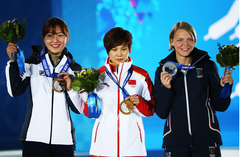 . Gold medalist Li Jianrou (C) of China is flanked by silver medalist Arianna Fontana (R) of Italy and bronze winner Park Seung-Hi of South Korea during the medal ceremony for Women\'s 500m of the Short Track events at the Sochi 2014 Olympic Games, Sochi, Russia, 13 February 2014.  EPA/TATYANA ZENKOVICH