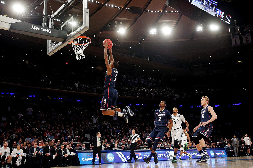 . Ryan Boatright #11 of the Connecticut Huskies dunks the ball in the first half against the Michigan State Spartans during the East Regional Final of the 2014 NCAA Men\'s Basketball Tournament at Madison Square Garden on March 30, 2014 in New York City.  (Photo by Bruce Bennett/Getty Images)