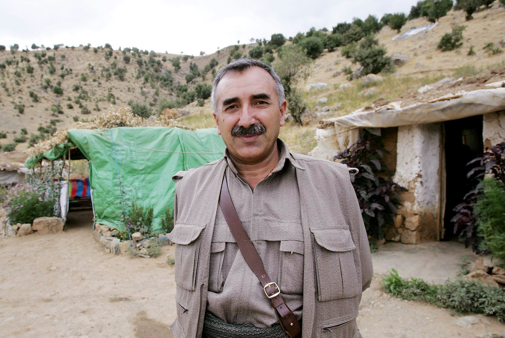 ". A file photo taken on August 11, 2005 shows Murat Karayilan, co-leader of the Kurdistan Worker\'s Party (PKK) and leader of the Kurdistan Democratic Confederalism Council (KKK), posing during an interview with AFP in a camp near Arbil in the Sinena mountains, northern Iraq. Kurdish rebels announced on April 25, 2013 that they would begin withdrawing from Turkey on May 5 into their safe haven in northern Iraq amid a peace drive between Ankara and the rebel movement. ""As part of ongoing preparations, the withdrawal will begin on May 5, 2013,\"" Murat Karayilan, the leader of the outlawed Kurdistan Workers\' Party (PKK), was quoted as saying by the pro-Kurdish Firat news agency. \""The withdrawal is planned in phases ... and is aimed to be finalised as soon as possible.\"" MUSTAFA OZER/AFP/Getty Images"