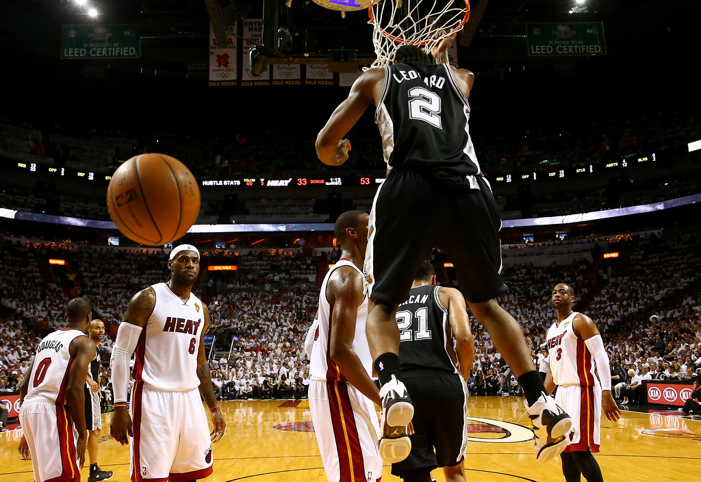 . MIAMI, FL - JUNE 12: Kawhi Leonard #2 of the San Antonio Spurs dunks against the Miami Heat during Game Four of the 2014 NBA Finals at American Airlines Arena on June 12, 2014 in Miami, Florida. (Photo by Andy Lyons/Getty Images)