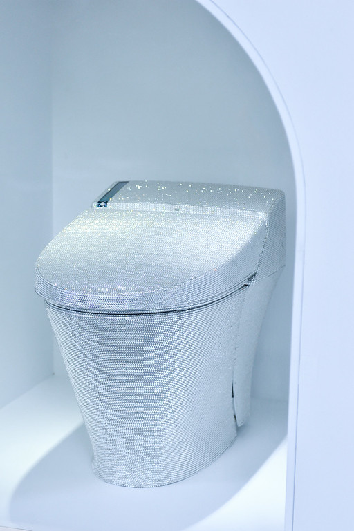 """. TOKYO, JAPAN - JULY 01:  A toilet decorated with crystal rhinestones is displayed with during the \""""Toilet!? Human Waste and Earth\'s Future\"""" exhibition at The National Museum of Emerging Science and Innovation - Miraikan on July 1, 2014 in Tokyo, Japan. The exhibition focuses on how the toilet has changed our daily lives and discovers what the most environment-friendly and ideal toilet is.  (Photo by Keith Tsuji/Getty Images)"""