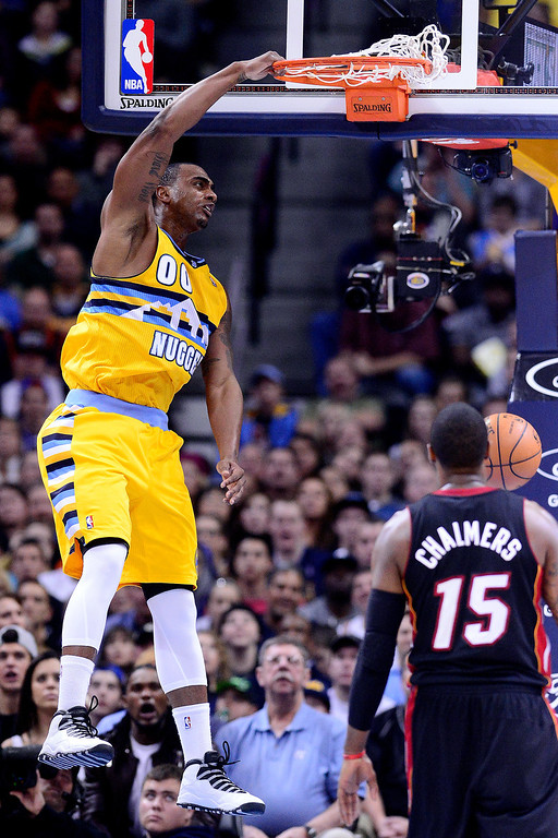. Darrell Arthur (00) of the Denver Nuggets dunks as Mario Chalmers (15) of the Miami Heat watches during the second half of Miami\'s 97-94 win. The Denver Nuggets hosted the Miami Heat at the Pepsi Center on December 30, 2013. (Photo by AAron Ontiveroz/The Denver Post)