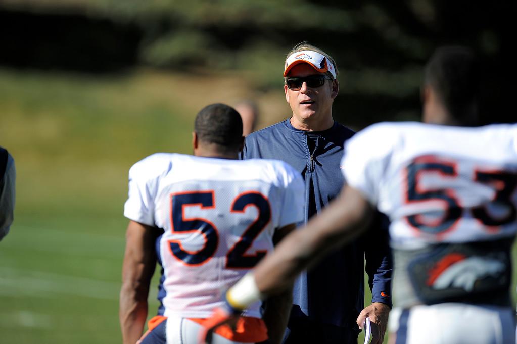 . Denver Broncos defensive coach/interim head coach Jack Del Rio talks with Denver Broncos outside linebacker Wesley Woodyard (52) before practice November 13, 2013 at Dove Valley (Photo by John Leyba/The Denver Post)