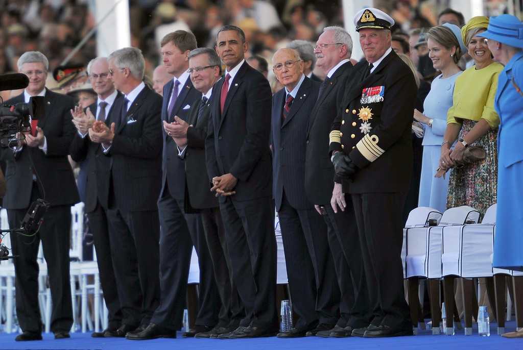 . (L to R) Canada\'s Prime Minister Stephen Harper, European Council president Herman Van Rompuy, Belgium\'s King Philippe, Netherland\'s King Willem-Alexander, Poland\'s President Bronislaw Komorowski, US President Barack Obama, Italy\'s President Giorgio Napolitano, Slovakia\'s president Ivan Gasparovic, Norway\'s King Harald V, Belgium\'s Queen Mathilde, Netherland\'s Queen Maxima, and Danish Queen Margrethe, prior to an international D-Day commemoration ceremony on the beach of Ouistreham, Normandy, on June 6, 2014, marking the 70th anniversary of the World War II Allied landings in Normandy. AFP PHOTO / GUILLAUME SOUVANT/AFP/Getty Images
