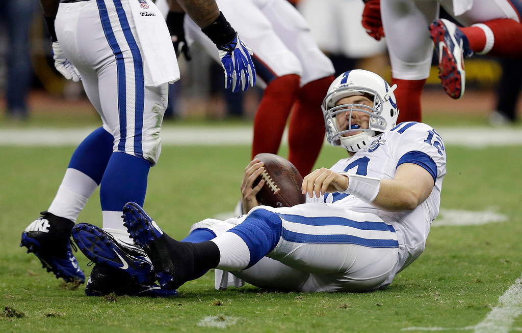 . Indianapolis Colts\' Andrew Luck lies on the turf after he was sacked during the second quarter of an NFL football game against the Houston Texans, Sunday, Nov. 3, 2013, in Houston. (AP Photo/David J. Phillip)