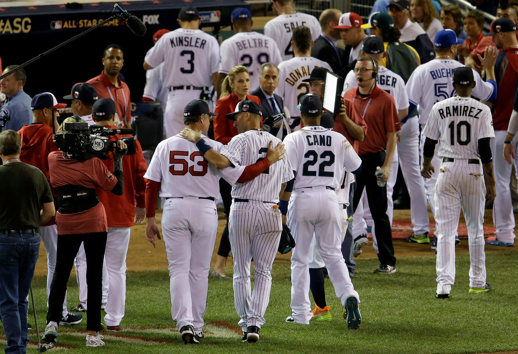 . American League shortstop Derek Jeter, of the New York Yankees, walks off the field with American League Manager John Farrell, of the Boston Red Sox (53) after their 5-3 victory over the National League in the MLB All-Star baseball game, Tuesday, July 15, 2014, in Minneapolis. (AP Photo/Paul Sancya)