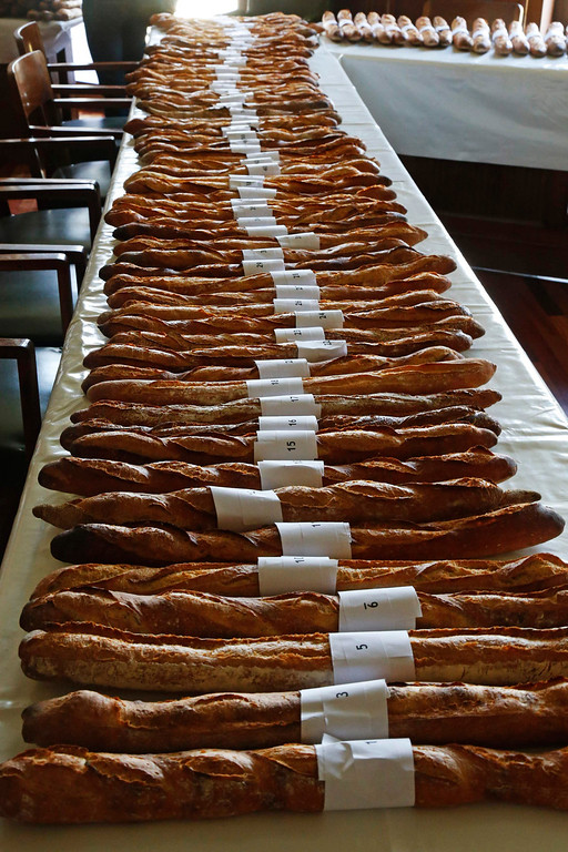 . Baguettes, French bread, selected in the competition for the \'Grand Prix de la Baguette de la Ville de Paris\' (Best Baguette of Paris 2013) annual prize are placed in a row at the Chambre Professionnelle des Artisans Boulangers Patissiers in Paris April 25, 2013. The baguette is a French cultural symbol par excellence and the competition saw 203 Parisian bakers who compete for recognition as finest purveyor of one of France\'s most iconic staples. The baguettes are registered, given anonymous white wrappings and an identification number. They are then carefully weighed and measured to ensure they do not violate the contest\'s strict rules. 52 entries were withdrawn for failing to measure between 55-70cm long or not matching the acceptable weight of between 250-300g. Every year, the winner earns the privilege of baking bread for the French President.   REUTERS/Charles Platiau