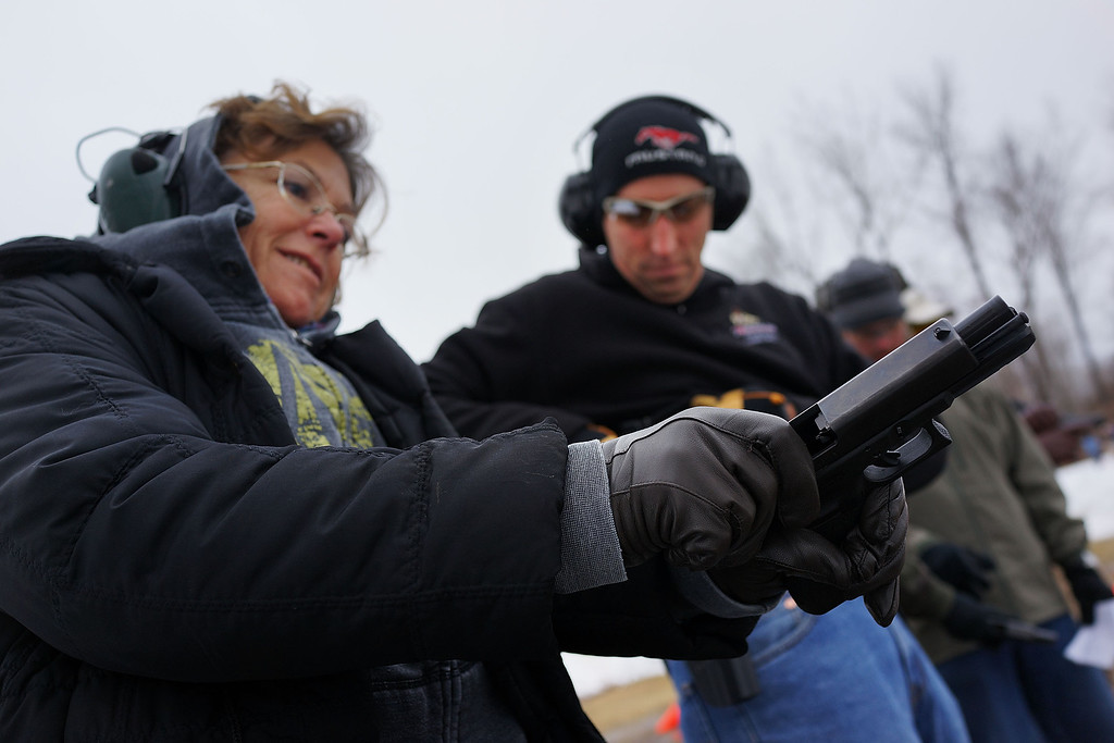 . Students learn to fire their pistols at a class taught by King 33 Training at a shooting range on February 24, 2013 in Wallingford, Connecticut. King 33 Training, a company that trains and educates individuals on the safe and proper use of guns and other uses of protective force, offers classes to marksmen of all levels. The Connecticut company offers training for clients interested in maintaining a safe environment for themselves, their families, and those around them. Connecticut, home to a number of gun manufactures including Colt Defense, is a state with conflicting views on guns and gun ownership. Currently the state has some of the strictest gun control laws in the nation and its current governor Daniel Malloy is pushing for tougher measures following the shootings at the Sandy Hook School.  (Photo by Spencer Platt/Getty Images)