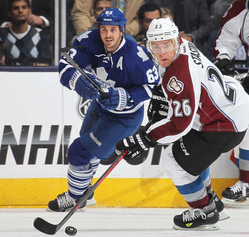 . Paul Stastny #26 of the Colorado Avalanche turns with the puck against the Toronto Maple Leafs during an NHL game at the Air Canada Centre on October 8, 2013 in Toronto, Ontario, Canada. (Photo by Claus Andersen/Getty Images)