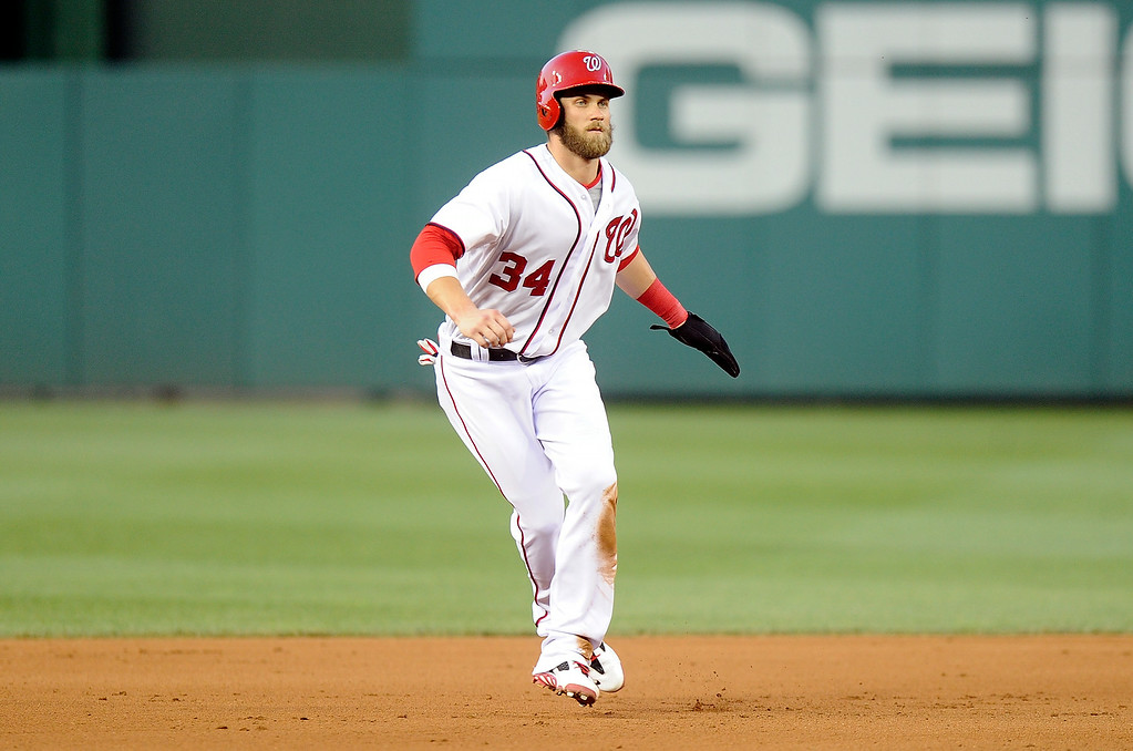 . WASHINGTON, DC - JUNE 30:  Bryce Harper #34 of the Washington Nationals takes a lead off of second base in the fourth inning against the Colorado Rockies at Nationals Park on June 30, 2014 in Washington, DC.  (Photo by Greg Fiume/Getty Images)