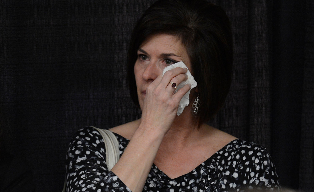 . DENVER, CO. - APRIL 2: Wife Bonnie of former DU hockey coach George Gwozdecky, wipes tears from her eyes as he addresses the media at a news conference April 2, 2013 at Magnuss Arena. Gwozdecky was on hand to discuss the school firing him on Monday. This ends his Pioneers coaching tenure at 19 seasons. (Photo By John Leyba/The Denver Post)