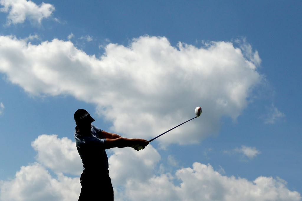 . Henrik Stenson, of Sweden, tees off on the fourth hole during the third round of the U.S. Open golf tournament at Merion Golf Club, Saturday, June 15, 2013, in Ardmore, Pa. (AP Photo/Charlie Riedel)