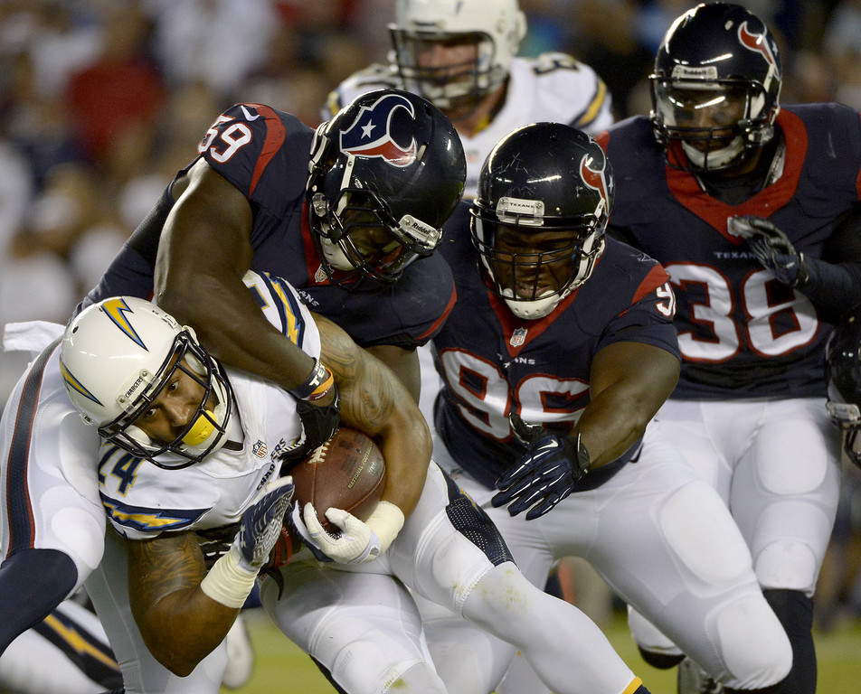 . Ryan Matthews #24 of the San Diego Chargers gets tackled by the Houston Texans on September 9, 2013 at Qualcomm Stadium in San Diego, California. (Photo by Donald Miralle/Getty Images)