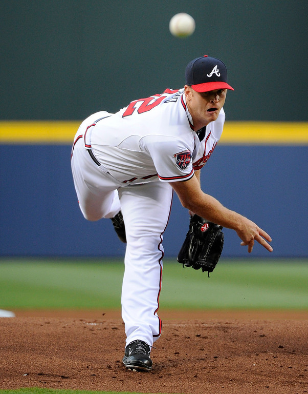 . Atlanta Braves starting pitcher Gavin Floyd delivers to the Colorado Rockies during the first inning of a baseball game Friday, May 23, 2014, in Atlanta. (AP Photo/David Tulis)