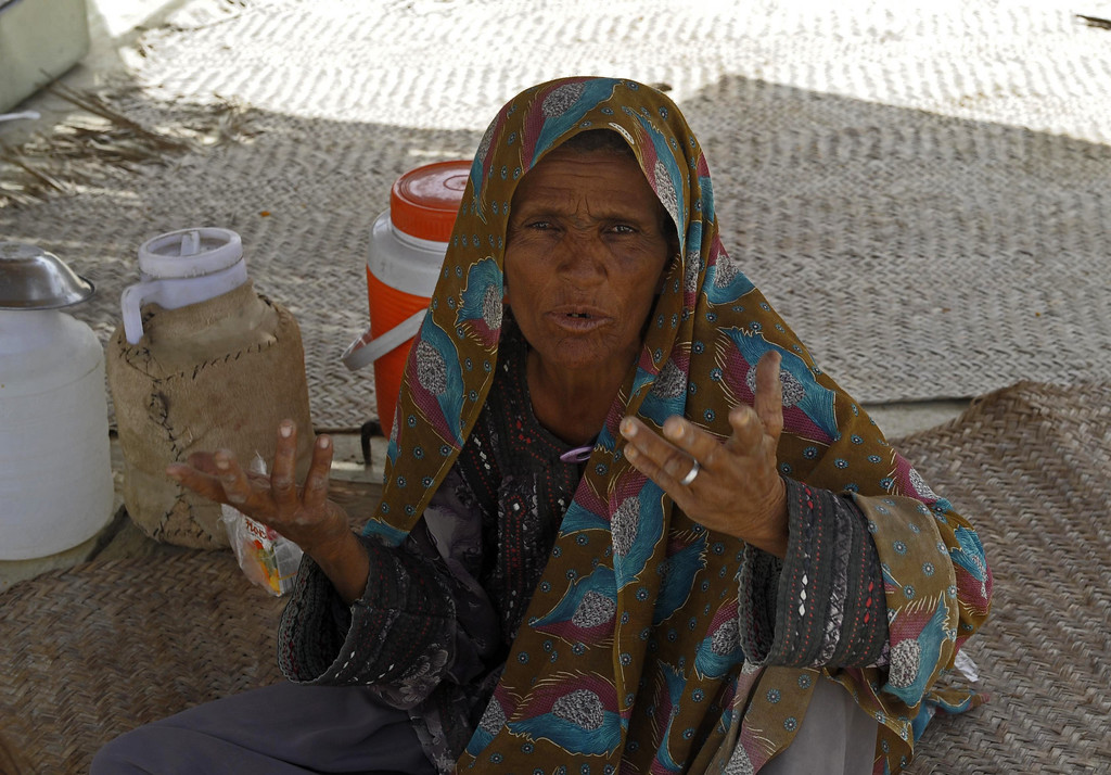 . A Pakistani elderly earthquake survivor gestures at a makeshift shelter in the devastated district of Awaran on September 25, 2013. A powerful 6.8-magnitude earthquake hit southwest Pakistan, in a region already devastated by a tremor which left more than 300 people dead and 100,000 homeless less than a week ago.  BANARAS KHAN/AFP/Getty Images