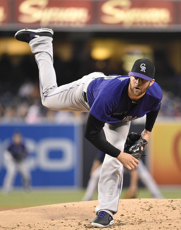 . Jordan Lyles #24 of the Colorado Rockies pitches during the first inning of a baseball game against the San Diego Padres at Petco Park August 11, 2014 in San Diego, California.  (Photo by Denis Poroy/Getty Images)
