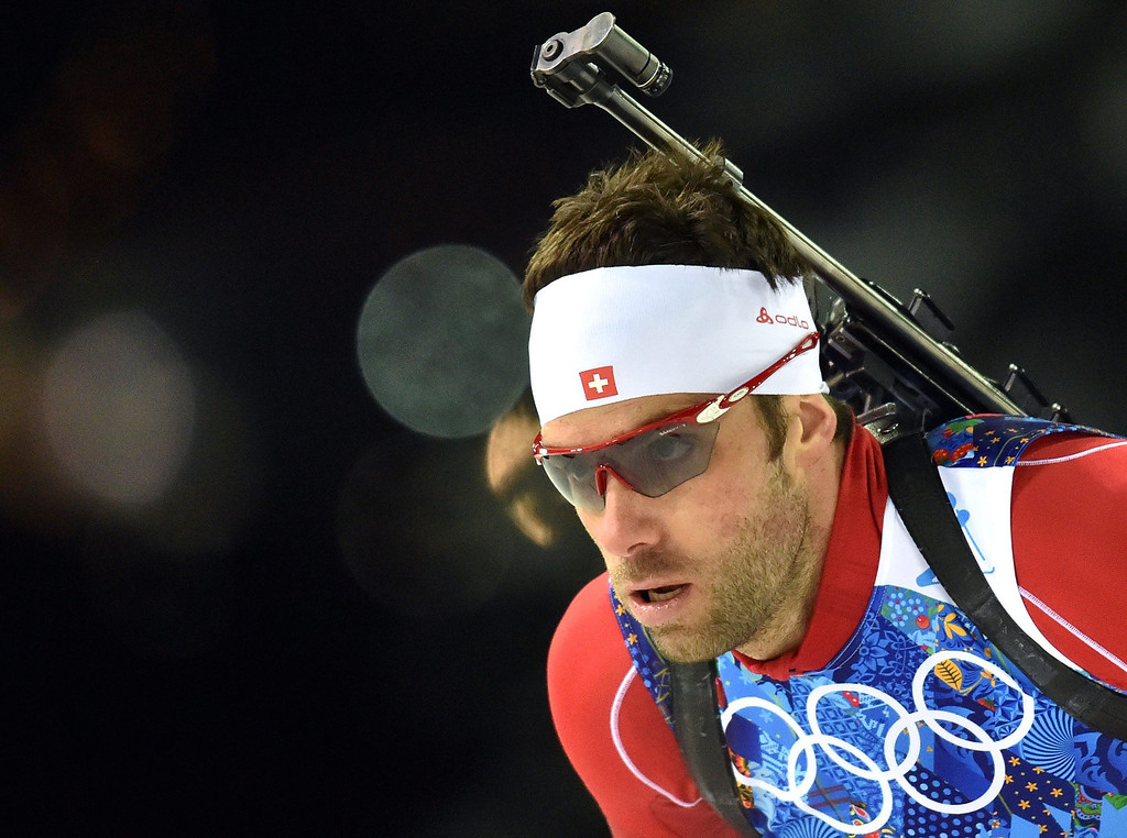 . Simon Hallenbarter of Switzerland in action during the Mixed Relay competition at the Laura Cross Biathlon Center during the Sochi 2014 Olympic Games, Krasnaya Polyana, Russia, 19 February 2014.  EPA/HENDRIK SCHMIDT