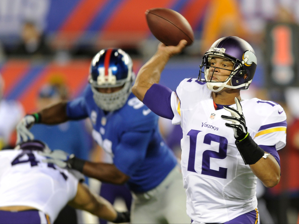 . Minnesota Vikings quarterback Josh Freeman (12) throws a pass during the first half of an NFL football game against the New York Giants Monday, Oct. 21, 2013 in East Rutherford, N.J. (AP Photo/Bill Kostroun)