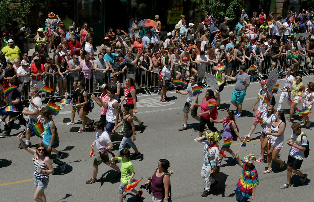 . The crowd cheers as the parade moves down Broadway Street during the Gay Pride Parade on Sunday, June 29, 2014 in Chicago. As many as 1 million people were expected to pack Chicago streets Sunday for the first Gay Pride Parade since Illinois legalized gay marriage last month. (AP Photo/Stacy Thacker)