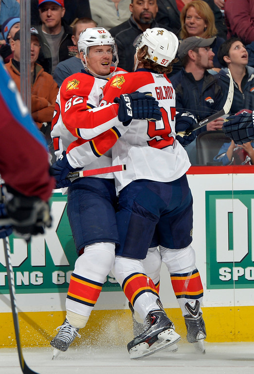 . Florida Panthers left wing Tomas Kopecky (82), from Slovakia, celebrates a goal with teammate Matt Gilroy (97) against the Colorado Avalanche during the second period of an NHL hockey game on Saturday, Nov. 16, 2013, in Denver. (AP Photo/Jack Dempsey)