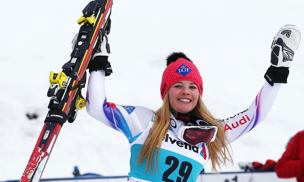 . Liechtenstein\'s Tina Weirather raises her arms as she walks to the podium after the women\'s World Cup giant slalom skiing event, in Beaver Creek, Colo., Sunday, Dec. 1, 2013. Weirather finished third. (AP Photo/Alessandro Trovati)