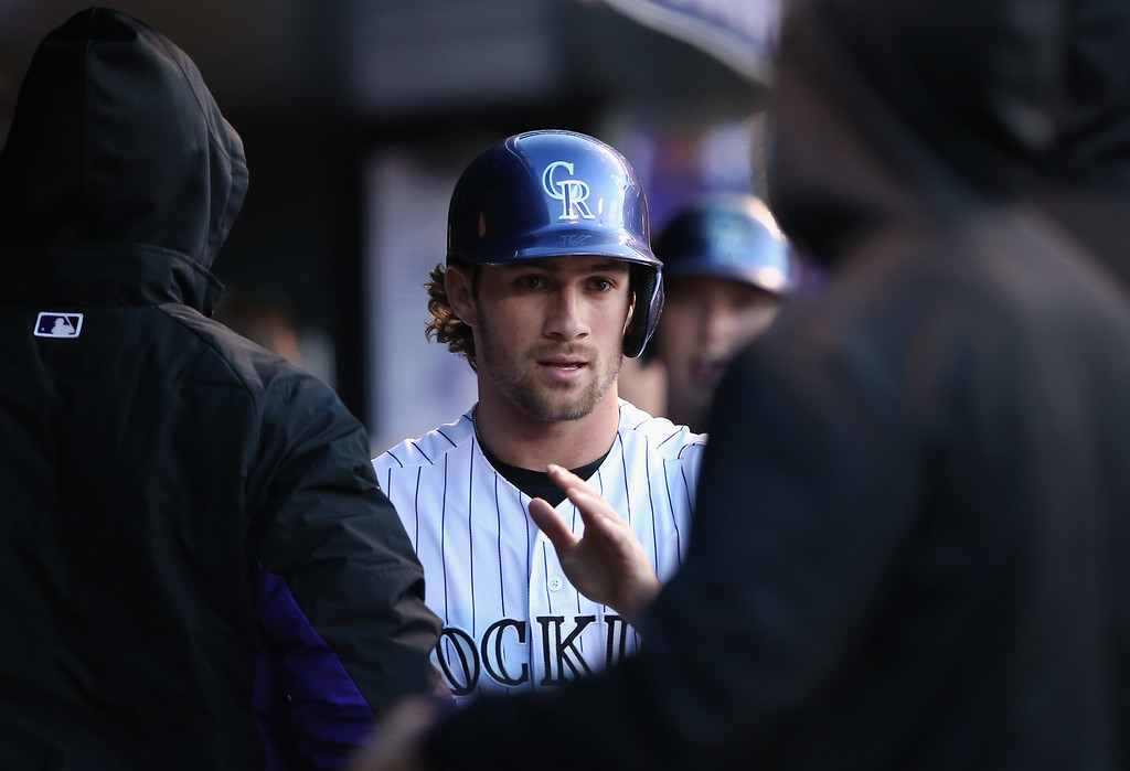 . Charlie Culberson #23 of the Colorado Rockies celebrates in the dugout after scoring on a two RBI single by Juan Nicasio #12 of the Colorado Rockies to take a 3-0 lead over the New York Mets in the second inning at Coors Field on May 1, 2014 in Denver, Colorado.  (Photo by Doug Pensinger/Getty Images)