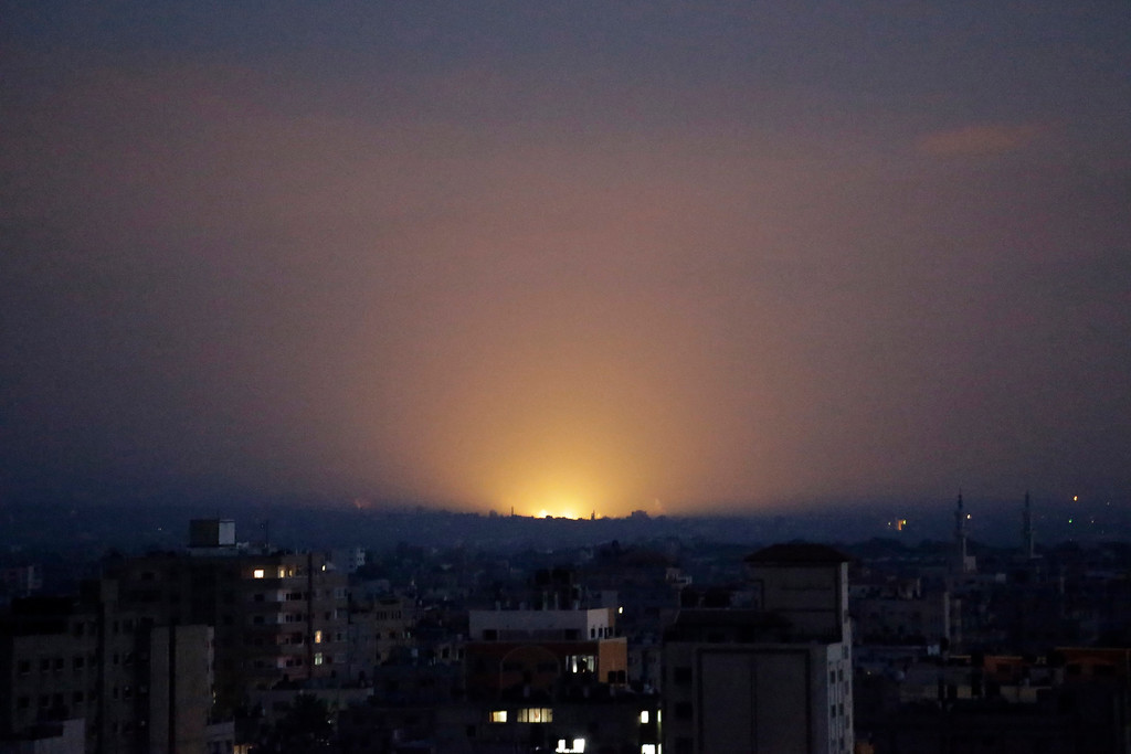 . Light from an Israeli strike in central Gaza Strip illuminates the sky, as seen from Gaza City, northern Gaza Strip, Thursday, July 31, 2014. (AP Photo/Lefteris Pitarakis)