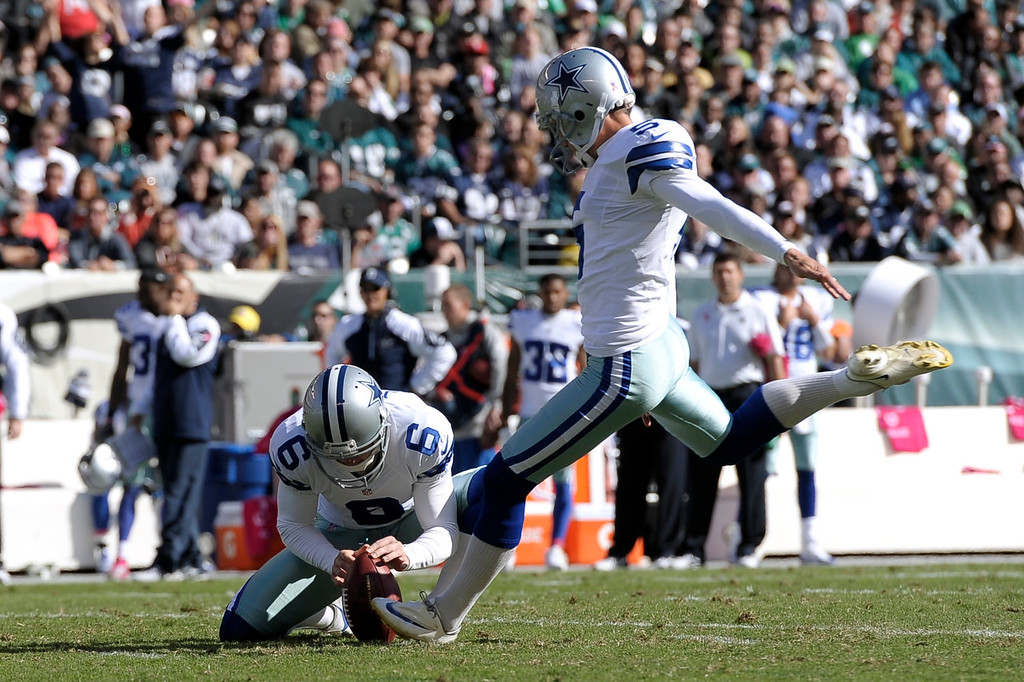 . Dallas Cowboys kicker Dan Bailey, right, with Chris Jones holding, kicks a field goal against the Philadelphia Eagles during the first half of an NFL football game, Sunday, Oct. 20, 2013, in Philadelphia. (AP Photo/Michael Perez)