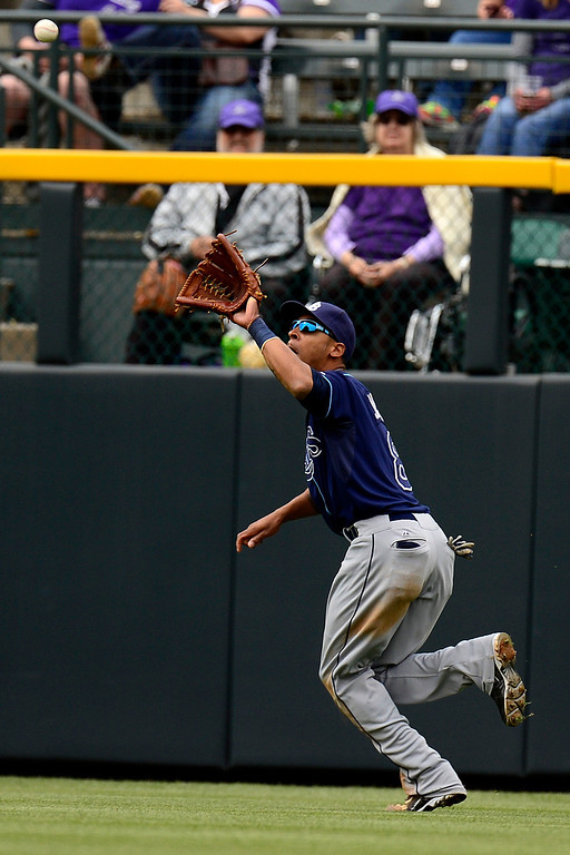 . DENVER, CO - MAY 5: Desmond Jennings (8) of the Tampa Bay Rays fields a fly ball during the Rockies 8-3 loss.   (Photo by AAron Ontiveroz/The Denver Post)