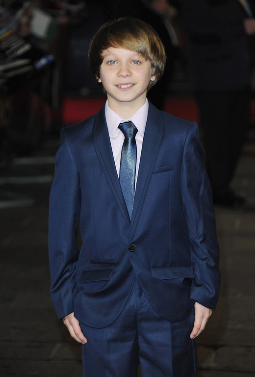 ". Daniel Huttlestone attends the ""Les Miserables\"" World Premiere at the Odeon Leicester Square on December 5, 2012 in London, England.  (Photo by Stuart Wilson/Getty Images)"