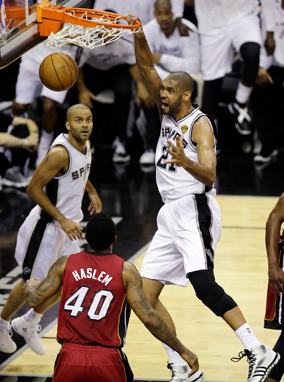 . San Antonio Spurs\' Tim Duncan (21) dunks during the first half at Game 3 of the NBA Finals basketball series against the Miami Heat, Tuesday, June 11, 2013, in San Antonio. (AP Photo/David J. Phillip)