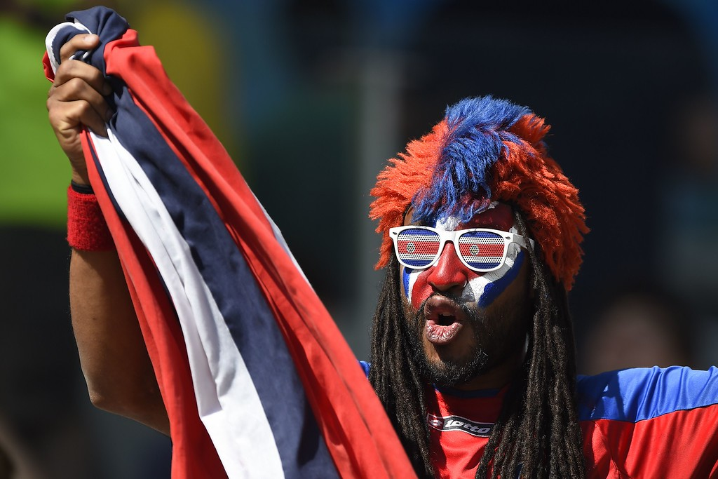 . A Costa Rica fan cheers before the start of a Group D match between Costa Rica and England at the Mineirao Stadium in Belo Horizonte during the 2014 FIFA World Cup on June 24, 2014.   AFP PHOTO / GUSTAVO  ANDRADE/AFP/Getty Images
