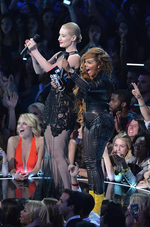 . Iggy Azalea (L) and Lil\' Kim speak onstage during the 2013 MTV Video Music Awards at the Barclays Center on August 25, 2013 in the Brooklyn borough of New York City.  (Photo by Rick Diamond/Getty Images for MTV)