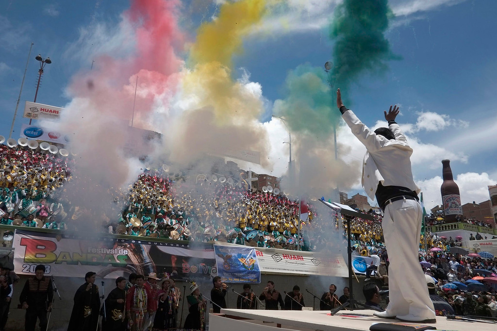 . Director Placido Jallasa conducts during a music festival in Oruro, about 200 km (124 miles) south of La Paz, February 2, 2013. Trumpet music and beating drums reverberated through the streets of the Bolivian city of Oruro to kick off pre-Carnival festivities. REUTERS/David Mercado