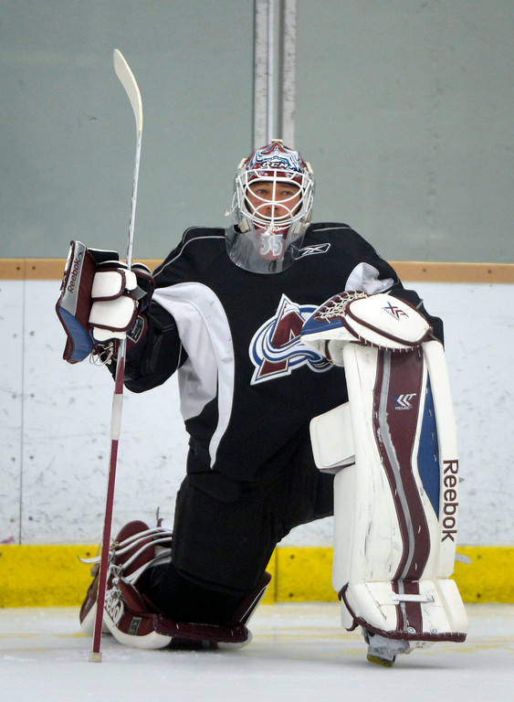 . Colorado Avalanche G J.S. Giguere (35) stretches before practice September 9, 2013 at Family Sports. (Photo By John Leyba/The Denver Post)