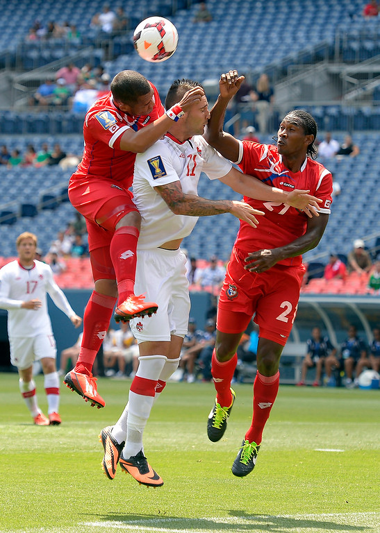 . Rolando Blackburn #16 of Panama and Richard Dixon #21 goes up for the ball on Jonathan Osorio #21 of Canada during the first half of the CONCACAF Gold Cup soccer game July 14, 2013 at Sports Authority Field at Mile High. (Photo By John Leyba/The Denver Post)