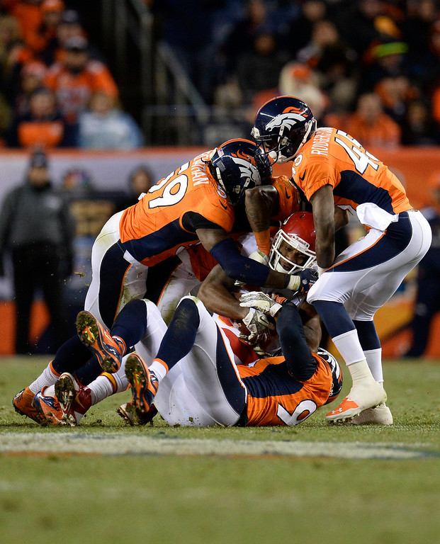 . Kansas City Chiefs running back Knile Davis (34) gets tackled in the third quarter. The Denver Broncos take on the Kansas City Chiefs at Sports Authority Field at Mile High in Denver on November 17, 2013. (Photo by John Leyba/The Denver Post)