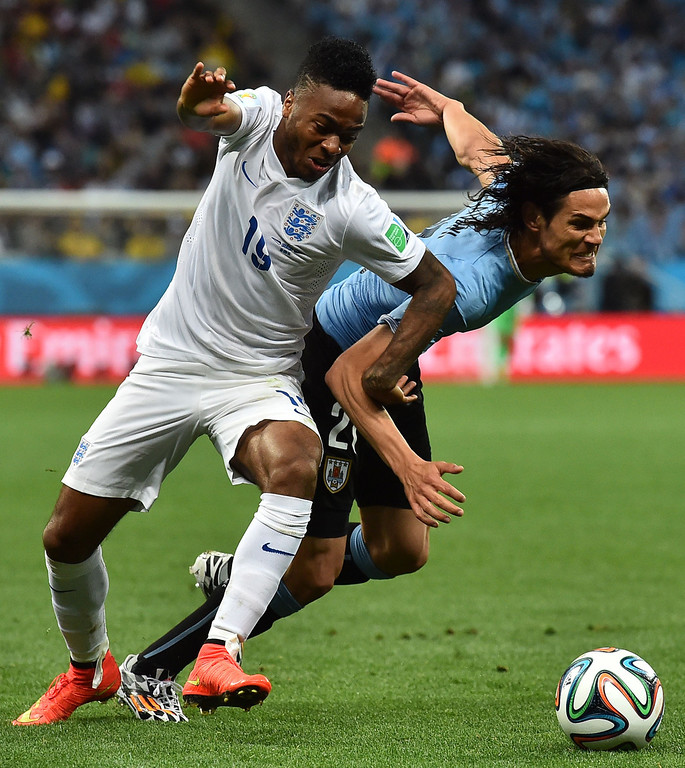 . England\'s midfielder Raheem Sterling (L) is challanged for the ball by Uruguay\'s forward Edinson Cavani during the Group D football match between Uruguay and England at the Corinthians Arena in Sao Paulo on June 19, 2014, during the 2014 FIFA World Cup.  BEN STANSALL/AFP/Getty Images