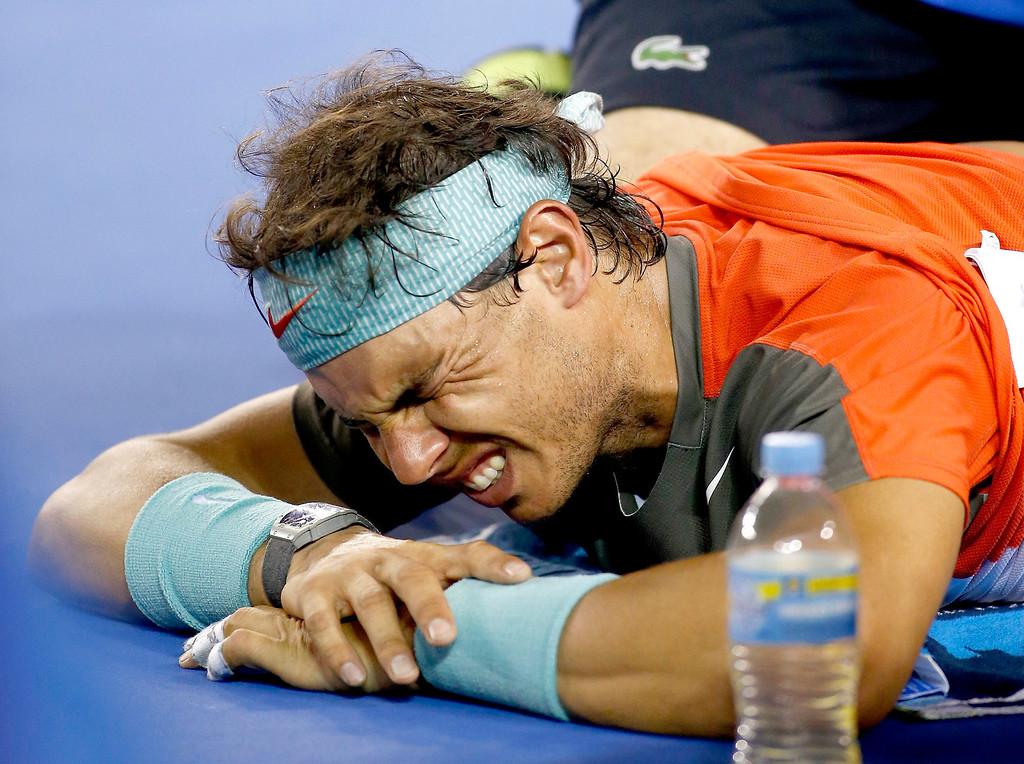 . Rafael Nadal of Spain grimaces as he receives medical treatment during his men\'s final match against Stanislas Wawrinka of Switzerland at the Australian Open Grand Slam tennis tournament in Melbourne, Australia, 26 January 2014.  EPA/MADE NAGI
